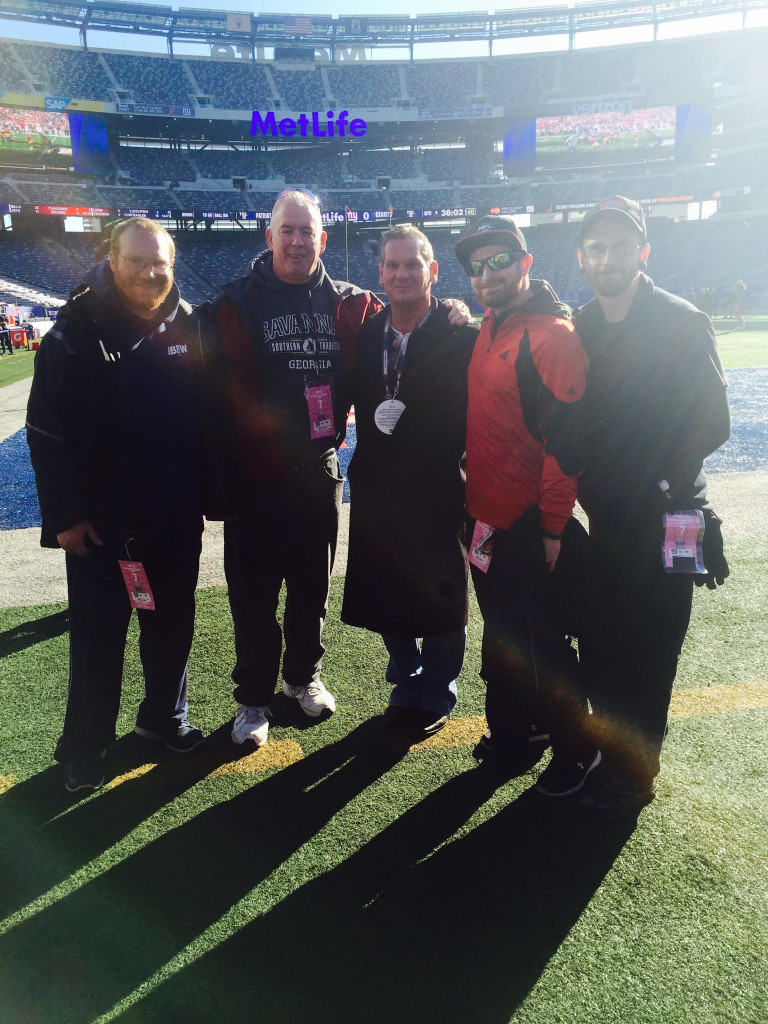 Business Manager Ralph Avigliano does a site visit to Met Life Stadium with members Brad Butler, John Sullivian and Tom Ryan.